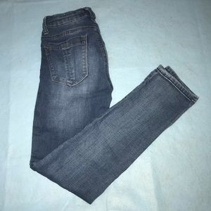 medium wash jeans with some rips